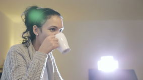 Beautiful brunette drinking coffee and smiling. stock video footage