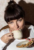 Beautiful brunette drinking coffee Stock Images
