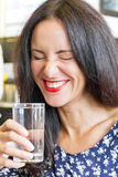 Beautiful brunette drinking water Stock Photography