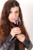 Beautiful brunette is drinking wine Royalty Free Stock Images