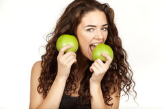 Beautiful brunette eating apple Royalty Free Stock Photos