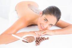 Beautiful brunette enjoying a chocolate beauty treatment Stock Photos