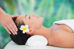 Beautiful brunette enjoying a head massage Royalty Free Stock Image