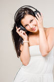 Beautiful brunette enjoying music. Stock Photography
