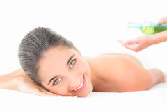 Beautiful brunette enjoying an oil massage. At the health spa royalty free stock photos