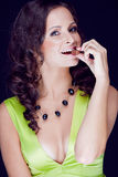 Beautiful brunette enjoys the chocolate Royalty Free Stock Photography