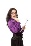 Beautiful brunette excited woman holding notebook and pen Stock Images