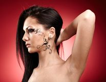 Beautiful brunette with facial tattoo Royalty Free Stock Photos