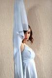 Beautiful brunette in fashion dress Royalty Free Stock Image