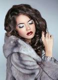 Beautiful brunette Fashion Woman in Mink Fur Coat. Makeup. Long Royalty Free Stock Photography