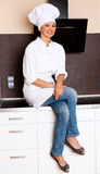 Beautiful Brunette Female Chef In Her Kitchen Royalty Free Stock Photo