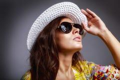 Beautiful brunette female in summer dress Stock Photos