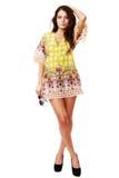 Beautiful brunette female in summer dress Stock Photography