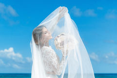 Beautiful brunette fiancee in white wedding dress with big long Royalty Free Stock Photo