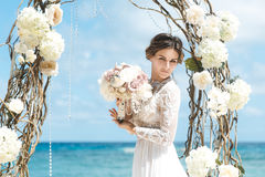 Beautiful brunette fiancee in white wedding dress with big long Royalty Free Stock Images