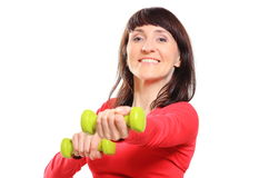 Beautiful brunette during fitness exercise with dumbbells Stock Photo