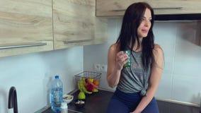 Beautiful brunette fitness model drinking detox juice