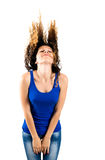 Beautiful brunette flipping hair. Isolated on white background Royalty Free Stock Images