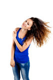 Beautiful brunette flipping hair. Isolated on white background Stock Photos