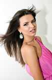 Woman flipping hair. Beautiful brunette flipping hair,  on white background Stock Images