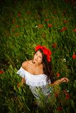 Beautiful brunette in flower field Royalty Free Stock Images