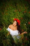Beautiful brunette in flower field Royalty Free Stock Images