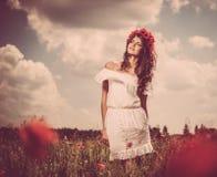 Beautiful brunette in flower field Stock Photos