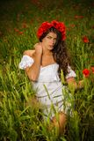 Beautiful brunette in flower field Royalty Free Stock Photos