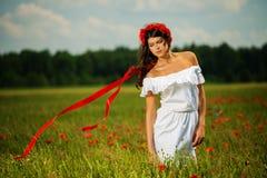 Beautiful brunette in flower field Stock Images
