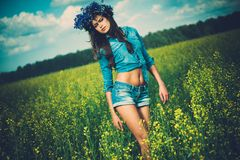 Beautiful brunette in flower field Royalty Free Stock Image