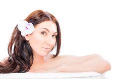 Beautiful brunette with flower in her hair Stock Photo