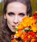 A beautiful brunette with flowers Stock Image