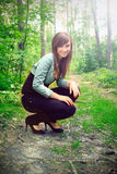 Beautiful brunette on a forest road Royalty Free Stock Photography
