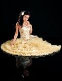 Beautiful brunette in formal dress Stock Photo