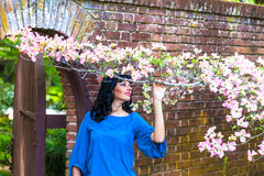 Beautiful brunette in the garden Royalty Free Stock Images