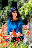 Beautiful brunette in the garden Stock Photos