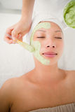 Beautiful brunette getting a facial treatment Royalty Free Stock Photography