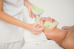 Beautiful brunette getting a facial treatment Stock Images