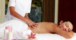 Beautiful brunette getting a massage Stock Photo