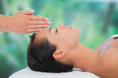 Beautiful brunette getting reiki therapy Stock Photography