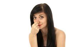 Beautiful brunette girl. Pinching her nose on white background close-up Royalty Free Stock Photography