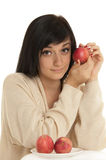 Beautiful brunette girl. Putting red apple  on white background Stock Photography