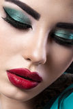 Beautiful brunette girl with arabic evening make-up and perfect skin. Beauty face. Close up Royalty Free Stock Photography