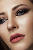 Beautiful brunette girl with arabic evening make-up and perfect skin. Beauty face. Close up.  Stock Image