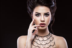 Beautiful brunette girl with arabic evening make-up and perfect skin. Beauty face. Royalty Free Stock Photography