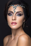Beautiful brunette girl with arabic evening make Royalty Free Stock Images