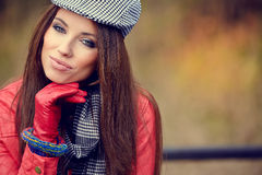 Beautiful brunette girl in autumn park. Warm sunny da Stock Images