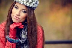 beautiful brunette girl in autumn park. Warm sunny da Stock Images
