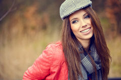 Beautiful brunette girl in autumn park. Warm sunny da Royalty Free Stock Images