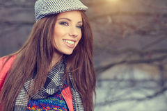 Beautiful brunette girl in autumn park. Warm sunny da Stock Photos